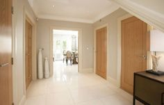 Light hallway with oak doors...again