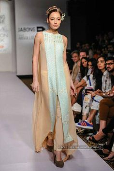 A model walks the ramp for Madsam Tinzin on Day 6 of the Lakme Fashion Week (LFW) Summer Resort 2015, held in Mumbai. (Pic: BCCL/Tejas Kudtarkar)(BCCL)See more of: LFW '15: Day 6: Madsam Tinzin