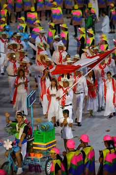 #RIO2016 Flag bearer Francisco Boza of Peru leads his team during the Opening Ceremony of the Rio 2016 Olympic Games at Maracana Stadium on August 5 2016 in...