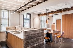 This is an old farmhouse recently renovated by Belgian studio JUMA Architects. For the thorough renovation of an old farm, JUMA Architects set out . Renovation D, Farmhouse Renovation, Stone Kitchen Island, Wooden Beams Ceiling, Old Bricks, B 13, Terrazzo Flooring, Pantry Design, Cuisines Design