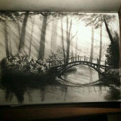 "Wonderous #charcoal #landscape #sketchbook #sketch by @charcoal_n_stuff of a #mysterious #forest #river #bridge. Love how the rays of light through the #trees and the #reflection in the water. Also I really enjoy how the bridge appears more ""in focus"" than the rest of the #drawing. Not sure if this was an artistic choice or just a result of this being only a sketch but I still think it's great!  #NatureAirship"