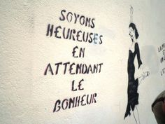 (Girls,) let's be happy while we wait for happiness. // Miss TIc graffiti, Paris, rue des Gobelins