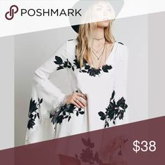 """White Long Sleeve Black Floral DRESS Lace NEW BRAND NEW!! Features a femme V-neckline, fun flared sleeves with lace detailing, & a beautiful floral print over a solid ethereal white. Extra long sleeves balance perfectly with this season's hemlines. **please note: sleeve opening: 18"""" (not as large as in pic).👌🏻  Looks great with jeans, & leggings, too!! Similar style by Free People. 🌟🌟Brand New, direct from the Manufacturer, & Sealed in Pkg. 🌟🌟  S: Bust: 33"""", Length: 32""""  M: Bust: 34""""…"""