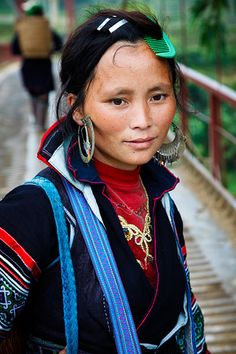 Portrait of a Black H'mong hill tribe woman wearing traditional indigo dyed clothing, in a small village near to Sapa called Lao Chai