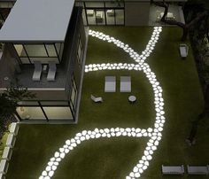 Lighting can add beautiful dimension to your outdoor space and so can stepping stones.  This just happens to be both!