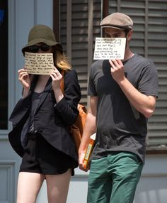 While dining at a restaurant in Manhattan this afternoon, Emma & Andrew noticed a group of photographers outside and decided to use their tried-and-true tactic to deal with them. | Andrew Garfield And Emma Stone Send Another Message To The Paparazzi