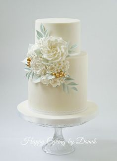 Classic white, gold and mint wedding cake.