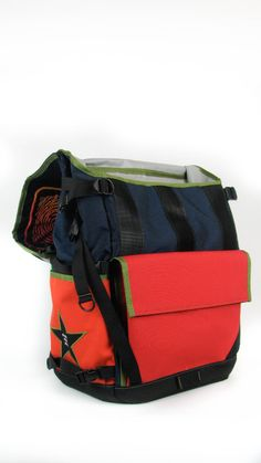 A flap open view of the waterproof flap top backpack we did for The Healing Loop