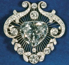 The Cullinan V Heart-Shaped Brooch-Cullinan V is an unusual heart-shaped diamond of 18.8 carats, set in a diamond and platinum surround intended to emphasize the heart shape. Like III and IV, the diamond was a gift from the South African government to Queen Mary.  Current owner is Queen Elizabeth