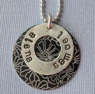 Very fun washer necklace.  Mom's love this one.   www.whimsicalheartstrings.com