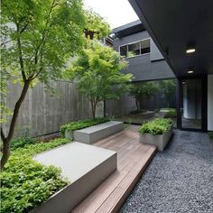 Love this outdoor urban retreat. It is modern and sleek, however is balanced by the trees and groundcover plants. Building designed by…