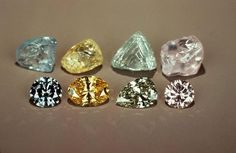 Rough and faceted fancy color diamonds. GIA (062413)