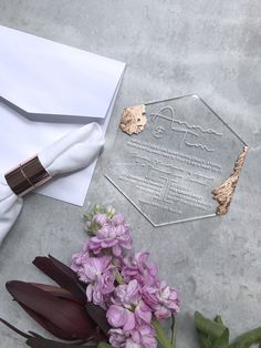 Clear acrylic hexagonal wedding invitation with white ink and hand applied copper fleck.