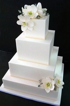 Tiers of traditional white cake are decked with ivory flourishes, satin ribbon and fresh white and pink roses. Tiers of traditional white cake are decked with ivory flourishes, satin ribbon and fresh white and pink roses. Wedding Cake Designs, Wedding Cake Toppers, Cake Wedding, Beautiful Wedding Cakes, Beautiful Cakes, White Square Wedding Cakes, White And Pink Roses, White Orchids, Gold Cake Topper