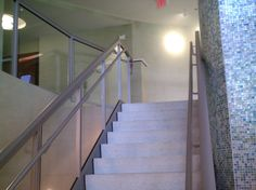 Interior Glass Railing Stairwell with incorporated Graspable Handrail by Atlantic Aluminum Products