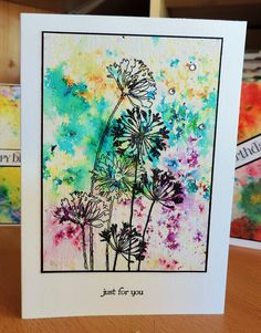 Card by Sue Ivings using Brusho for the background and  Agapanthus stamp set by Stampendous.