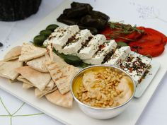 Get this all-star, easy-to-follow Greek Mezze Platter recipe from Ina Garten