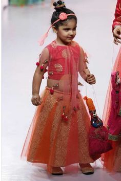 An ethno-fusionattire for a traditional look with a modern twist; the choli is paired with a cape saving the little girls of the troubles of handling a dupatta. With all its bells and whistles, this designer wear will make her a little Indian doll on this special Indian occasion. #stylemylo #kidsfashion #kidswear #designerwear #kidsoutfit #newcollection #indianwear #onlineshopping #babyboy #babygirl #rakshabandhan