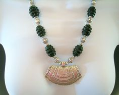 Dark Green Molded Glass Bead Necklace - Grooved Green Barrels, Bali Like Silver Metal Beads, Incised Silver Metal Ethnic Pendant - #1055 by bonnard22 on Etsy https://www.etsy.com/listing/516699368/dark-green-molded-glass-bead-necklace