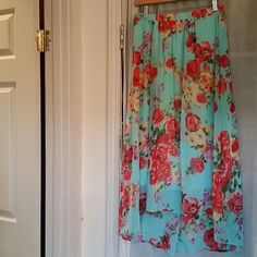 """Floral print high low skirt perfect for summer Super cute flower print skirt. Waist has elastic band. Size small measures 14"""" wide 31"""" long in front and 37"""" long in back. The skirt is lined and is not see through when sun hits it. Looks great with a skin color leotard under worn as top! Worn a cpl times but in great condition,  no snags or pulls. bobeau Skirts High Low"""