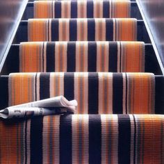 Modern stairs carpet  Stripes of varied widths in contemporary tones make the staircase a focal point in any hallway. A flash of floorboards either side of the runner keeps the look modern.