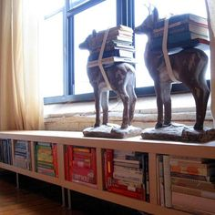 These low shelves are great bench seating....and you can make it more fun by styling your books by color, or some other theme.