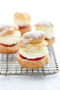 A no-bake cheesecake filling tops strawberry jam in these light and airy cream puffs that are a surprisingly easy dessert to make at home.
