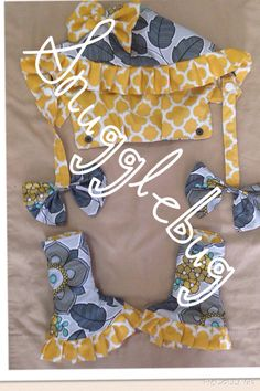 Tula gray zz / arrows hoodie with floral pattern ruffles and bows, corner ruffled teething pads and reach straps  with bows