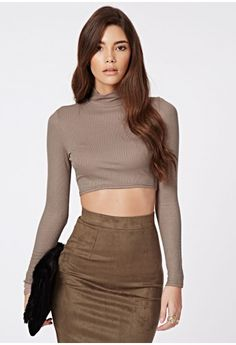 "Bring your wardrobe up-to-date in this 90's inspired ribbed turtle neck crop top. We're major fans of this style. For the ultimate 90's look team with high waist skinny jeans and chunky boots.  Approx length 39cm/15.2"" (Based on a UK si..."