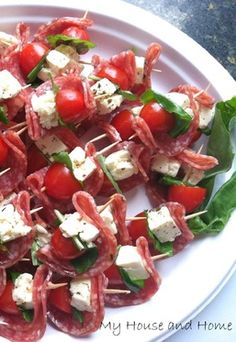 Salami, feta, basil, and tomato appetizers… an easy finger food.