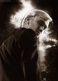 day 4 Favorite Villain-Draco Malfoy. I feel so bad for him!! It's all his parents fault he was bad!!!