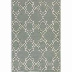 Equally at home on the patio or in your foyer, this artful indoor/outdoor rug brings an eye-catching pop of style to your decor with its geometric trellis motif. Made in Egypt.   Product: RugConstruction Material: 100% PolypropyleneColor: CreamFeatures:  Machine madeMade in EgyptSuitable for indoor and outdoor use Thin pileNote: Please be aware that actual colors may vary from those shown on your screen. Accent rugs may also not show the entire pattern that the corresponding area rugs…