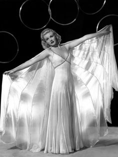 I'm in Love with this white Gown, Ginger Rogers wore in the 1936 movie Swing Time. OMG The I dare you to Kiss him (Fred Astaire) scene Behind the door. Classic. Love<3