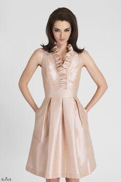 Pearl Pink poly shantung cocktail dress featuring a gathered, victorian style, v neck line and pleated skirt.