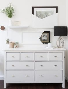 Simple decor on the top of a dresser. Minimalist decorating - looks clean and organized!
