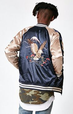 Add a dose of retro-meets-modern to your look with this sick PacSun jacket. The Eagle Souvenir Zip Jacket features a shiny two-tone design, a embroidered eagle design on the back, and striped ribbed detailing at the neck, cuffs, and hem.   Shiny, two-tone souvenir jacket Embroidered eagle on chest and back Front hand pockets Raglan long sleeves Ribbed neck, cuffs, and hem with striped detailing Zipper front