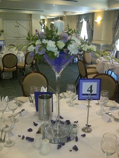 #lilac #ivory #white #hydrangea #rose #lisianthus #orchid #aster #guest #table #centre #arrangement #martini #vase #tall #kent #London #wedding #chicweds #chicweddings
