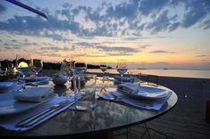 An experienced Destination Management Company DMC providing exclusive MICE services for Conferences, Incentive trips, Car launches, Teambuilding Management Company, Athens Greece, Team Building, Corporate Events, Airplane View, Seaside, Restaurant, Sunset, Dining