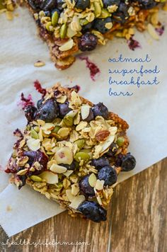 These Oatmeal Superfood Breakfast Bars will become your newest addiction, loaded with healthy ingredients like oats, pumpkin seeds and blueberries.