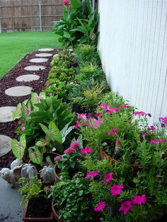 """I want to tear out the """"sidewalk"""" on the side of our house and do something more landscaped like this.   Photo by mabecerra, via Flickr"""