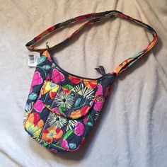 Purse Not listed Brand. This is a Vera Bradley purse never used and still with tags. Very adorable. It has an outside pocket that clips shut with a magnet and a large pocket can hold a good sized wallet, phone, and other accessories. kate spade Bags Crossbody Bags