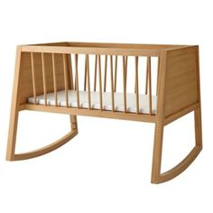 Inspired by vintage cradles, our Olin Bassinet has a clean, modern design and solid teak construction. Plus it features a rounded base, allowing it to gently rock. And, while we don't recommend putting it in the tree tops, we do recommend keeping one in your home. Safety first Meets or exceeds all U. S.