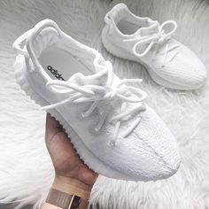 All white women's Yeezy sneakers. At TheShoeCosmetics all white trainers are the canvas, the fresh face to a sneaker makeover. An all white pair of Yeezy tennis shoes are perfect canvas for a customized sneaker. Moda Sneakers, Sneakers Mode, Best Sneakers, Sneakers Fashion, Fashion Shoes, 90s Fashion, Adidas Sneakers, Adidas Shoes Women, Adidas Nmd
