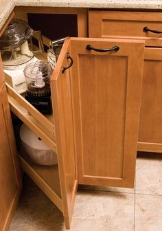 "The KitchenMate Corner Pantry is a truly unique alternative to the traditional lazy susan. Fabricated from solid maple and plywood construction, this unit comes fully assembled and pre-mounted with a plywood sled for easy installation. <ul> <li> Designed for 36"" corner cabinet.</li> <li> Features heavy-duty, 125lb. full extension slides.</li> <li> Perfect for remodels, can be easily installed even with existing countertop intact.</li> <li> NOTE: Door NOT included.</li> </ul>"