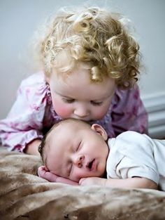 little girl with blonde curls kissing new baby brother•❤•