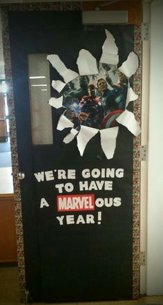 The door to my classroom had to match my theme this year: THE AVENGERS! I'm definitely ready for a MARVELous year! - Visit to grab an amazing super hero shirt now on sale! Superhero Classroom Door, Disney Classroom, Classroom Bulletin Boards, New Classroom, Classroom Displays, Classroom Themes, Classroom Organization, Superhero Bulletin Boards, Superhero School Theme