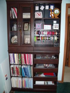 This idea is compliments of a blog friend of mine.  She used 4 closet components to build her cross stitch armoire.  How clever is this?