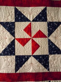 close up, Red White & Blue star quilt by Kim M.  Posted by Julie at Simply Divine Quilts.  Quilted with high-contrast thread.