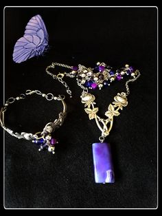 Handmade silver rose spoons with a lavender blue gemstone and