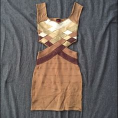 NWOT Bandage Dress Neutral with a twist. Really pretty bondage dress, just a little bit too small for me. I'm generally an XS/0 so maybe better for someone who wears a 00. So sad because it's a cute dress! Make me an offer!  2B Bebe Dresses